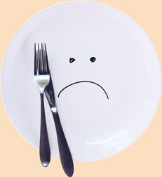 Plate with a sad smiley face
